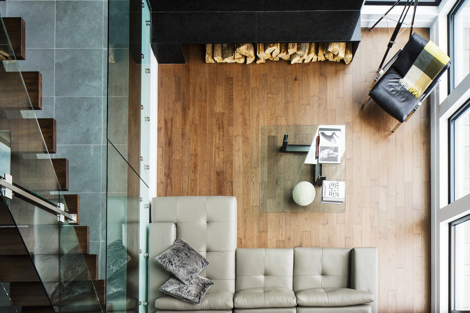 Tagged: Living Room, Medium Hardwood Floor, Sectional, and Chair.  Modern Lake Cabin by BONE Structure