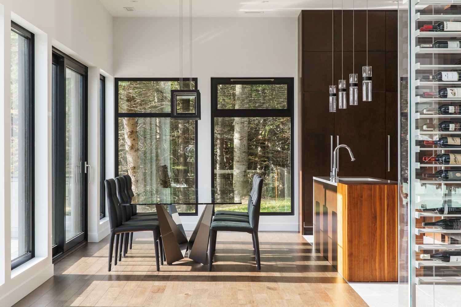 Tagged: Dining Room, Table, Chair, Pendant Lighting, and Light Hardwood Floor.  Modern Lake Cabin by BONE Structure