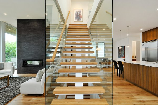 Modern home with staircase, wood tread, and wood railing. Photo 5 of Acacia Residence