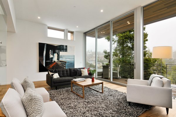 Modern home with living room, chair, and coffee tables. Photo 4 of Acacia Residence
