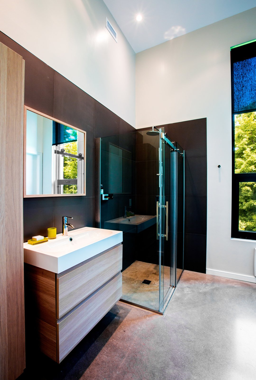 Tagged: Bath Room, Concrete Floor, Corner Shower, Enclosed Shower, and Recessed Lighting.  The Desjardins Residence by BONE Structure