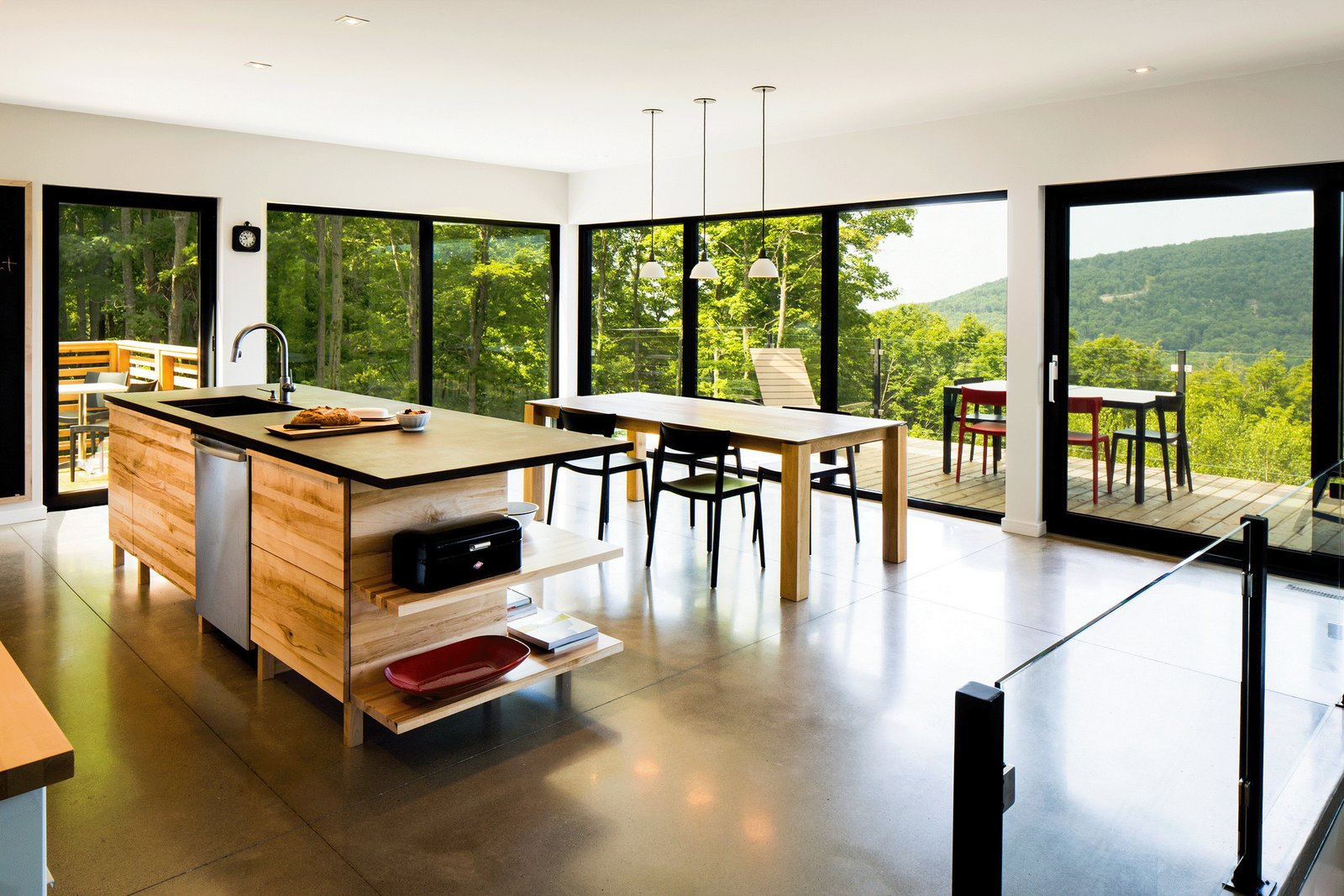 Tagged: Kitchen, Dishwasher, Wood Cabinet, Concrete Floor, Pendant Lighting, and Undermount Sink.  The Desjardins Residence by BONE Structure