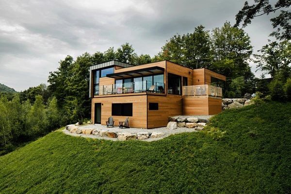 Modern home with outdoor, front yard, and boulders. Photo 7 of The Desjardins Residence