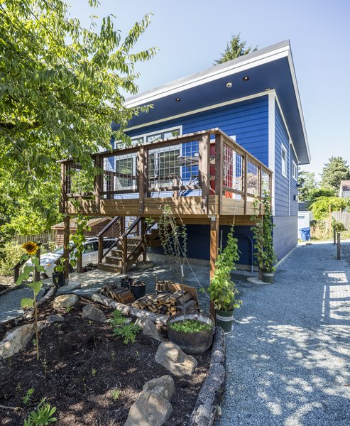 Exterior stairs were designed and built to utilize all 800 sqt ft (the maximum permitted for Seattle backyard cottages) for interior livable space.  © Cindy Apple Photography Photo  of Sustainable Backyard Cottage modern home