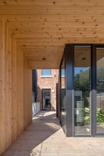 Rear portico framing rear access to house