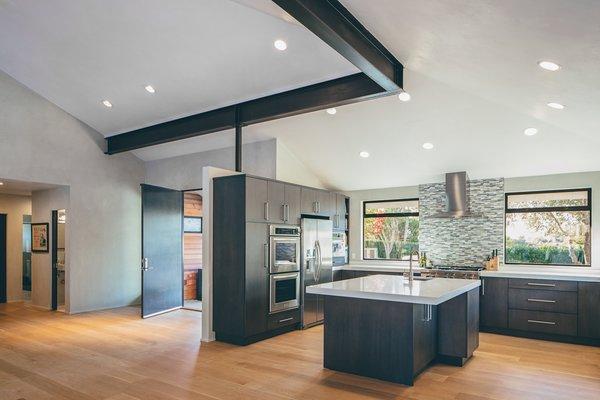 Modern home with kitchen, medium hardwood floor, and wood cabinet. Photo 3 of Crestline