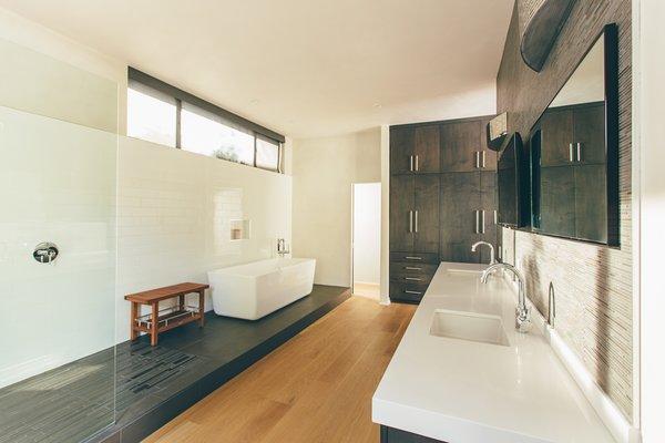 Modern home with bath room, engineered quartz counter, undermount sink, medium hardwood floor, freestanding tub, corner shower, open shower, and soaking tub. Photo 7 of Crestline