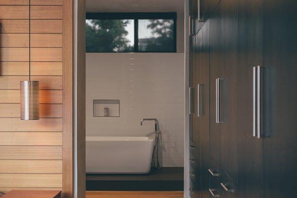 Modern home with bath room, freestanding tub, soaking tub, pendant lighting, and subway tile wall. Photo 8 of Crestline