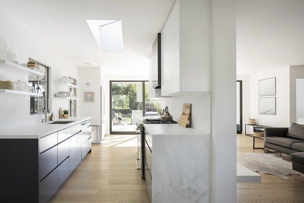 Modern home with kitchen, drop in sink, and light hardwood floor. Photo 4 of Vista De la Cumbra