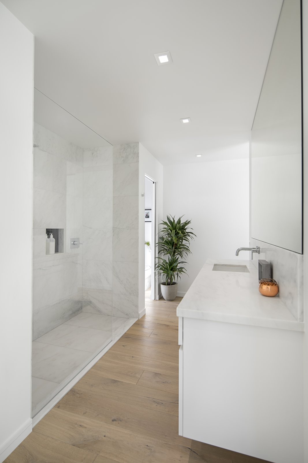 Tagged: Bath Room, Light Hardwood Floor, Drop In Sink, Open Shower, and Ceiling Lighting.  Vista De la Cumbra by ANACAPA