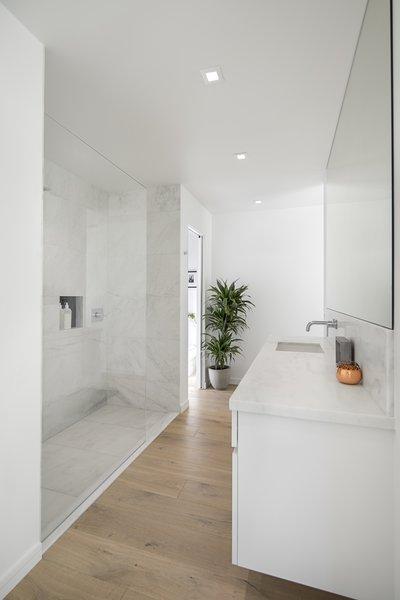 Modern home with bath room, light hardwood floor, drop in sink, open shower, and ceiling lighting. Photo 7 of Vista De la Cumbra