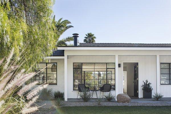 Modern home with outdoor, small patio, porch, deck, grass, and back yard. Photo 9 of Vista De la Cumbra