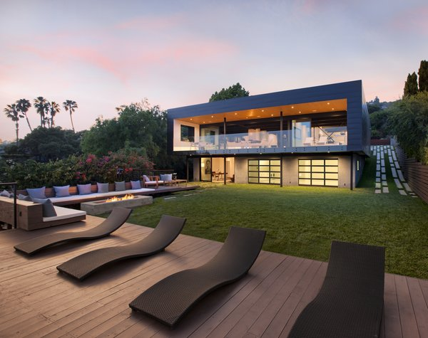 Modern home with outdoor, back yard, large patio, porch, deck, wood patio, porch, deck, and grass. Photo 15 of Paseo Ferrelo