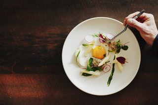 A delicate side dish with morels poached in beurre monte, asparagus and egg on ramp top puree.