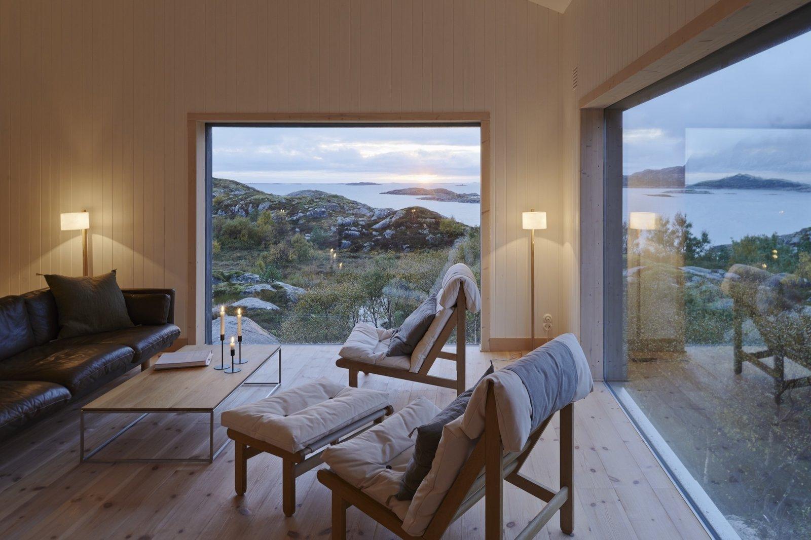 Vega Norge, Erik Kolman Janush Tagged: Living Room, Coffee Tables, Chair, Light Hardwood Floor, and Sofa.  Photo 6 of 14 in Naked Naust