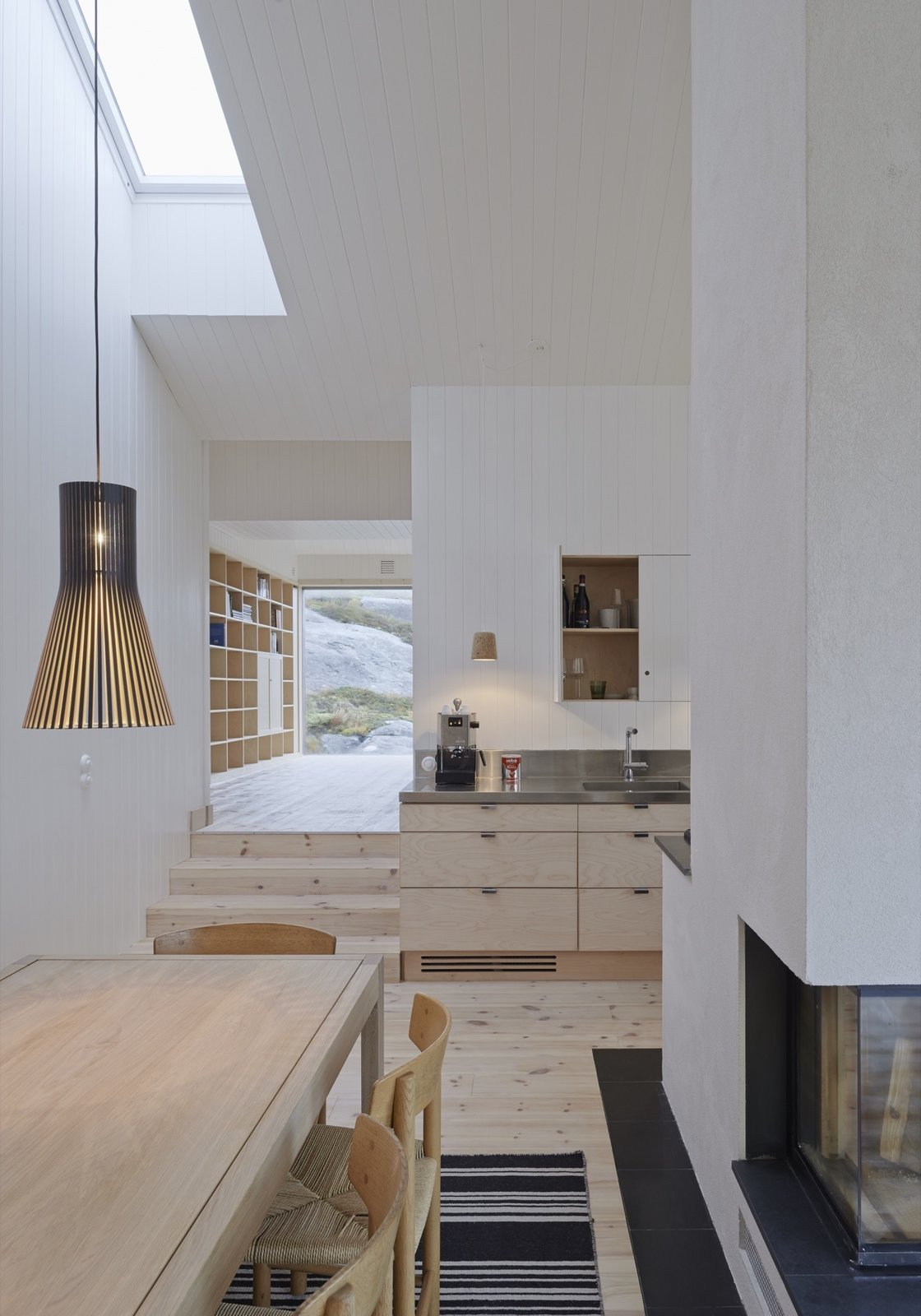 Tagged: Kitchen, Wood Cabinet, Light Hardwood Floor, Pendant Lighting, and Metal Counter.  Modern Danish Homes We Love by Aileen Kwun from Naked Naust