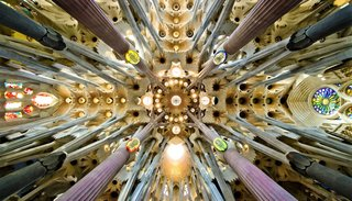 Slow Architecture - Photo 6 of 11 - Sagrada Família Basílica & Temple / Detail of the roof in the nave. Gaudí designed the columns to mirror trees and branches.