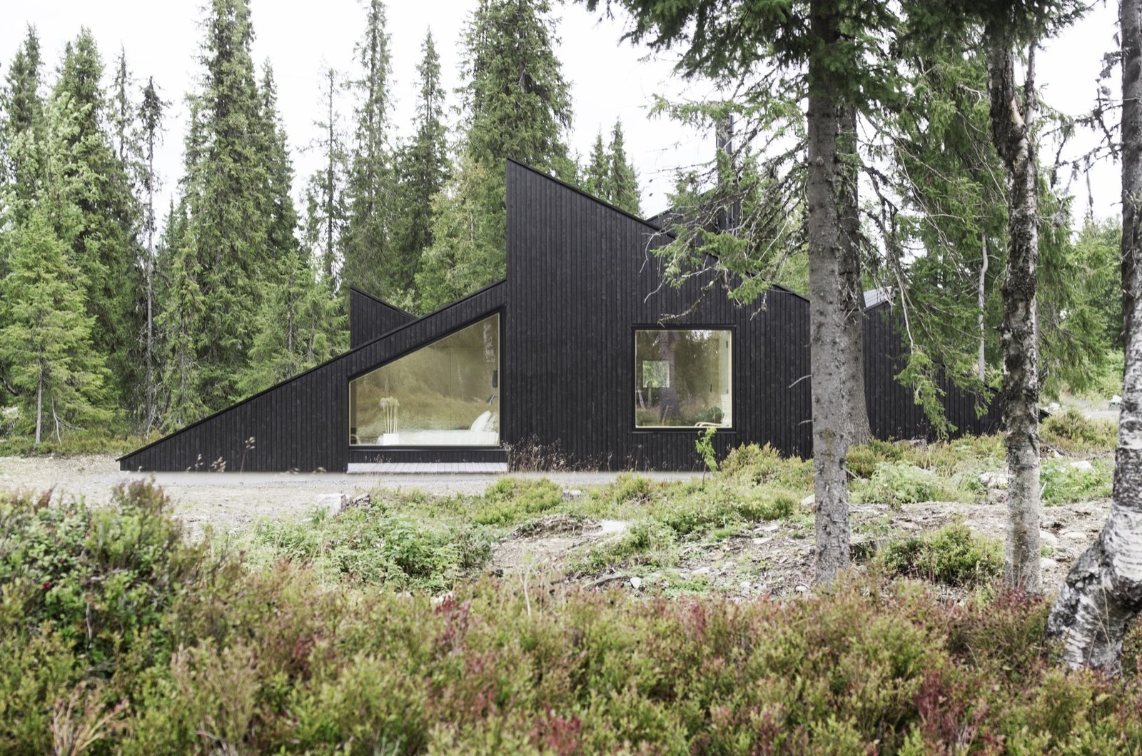 The concept of this Scandinavian getaway was simple: To create a cabin that is small and sparse yet spatially rich. The 55-quare-meter (592-square-foot) cabin, commissioned by a private client and completed in 2016, comprises a large living room, bedroom, ski room, and small annex with a utility room. It functions off the water and electricity grids. Tagged: Outdoor.  Photo 11 of 18 in The Vindheim Cabin: Snowbound in Norway