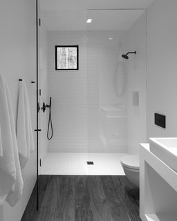 Retreat in the Aspen Grove - Photo 9 of 12 - The minimalistic bathroom at the center of the studio separates the sleeping area from the living area .