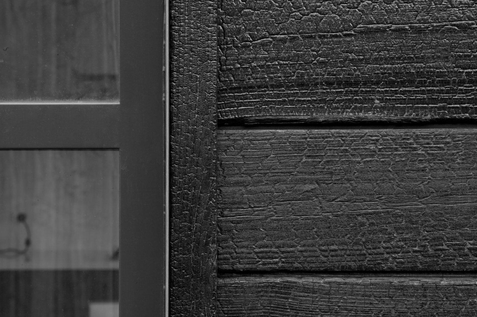 Charred cedar wood gives the cottage's exterior a rough, bark-like texture Retreat in the Aspen Grove - Photo 6 of 13