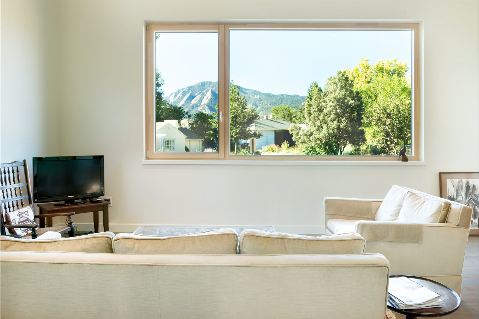 Zola Tilt & Turn and Fixed Window - Zola Thermo Clad  Tilt & Turn windows can be very large, with each sash up to five and a half feet wide. Zola Tilt & Turn windows have a multi-point locking mechanism providing safety and superb air sealing.  Sunset by Zola Windows