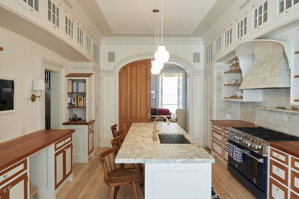 Kitchen designed by architect Louis Mackall. Cabinet fabrication by James Schriber Furniture. Tile backsplash by Mosaic House in NY, specializing in Moroccan Tiles.   Architect Louis Mackall designed two archways, with custom arched pocket doors from Breakfast Woodworks for the parlor opening. Photo 7 of Carroll Gardens Passive House modern home