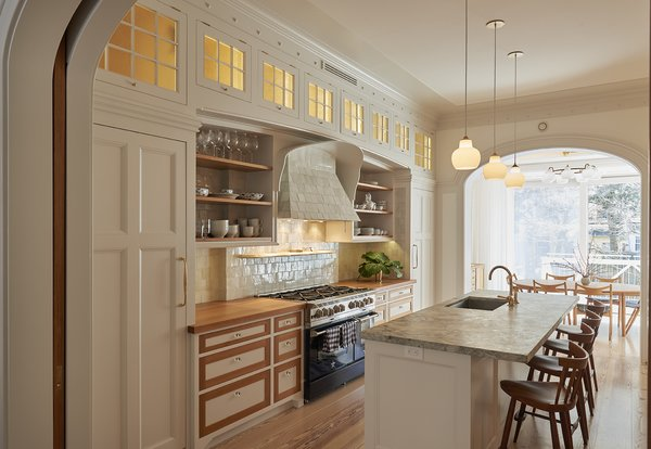 Kitchen designed by architect Louis Mackall. Cabinet fabrication by James Schriber Furniture. Tile backsplash by Mosaic House in NY, specializing in Moroccan Tiles.   Architect Louis Mackall designed two archways, with custom arched pocket doors from Breakfast Woodworks for the parlor opening. Photo 9 of Carroll Gardens Passive House modern home