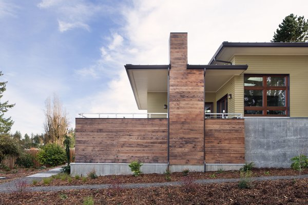True to the prairie style, the form was kept low and friendly with hipped roofs and broad overhanging eaves. Photo 4 of Prairie Passive modern home