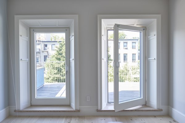 This 5-story 1860's Brooklyn townhouse features Zola's triple-glazed Thermo Clad windows and doors in FCS-certified pine. Finding high performance windows that were large and quality-crafted was an important aspect of combining the passive house standard with the original intent of a top-notch design and tasteful renovation of the historic home.  http://www.zolawindows.com/thermoclad/ Photo  of Carroll Gardens Passive House modern home
