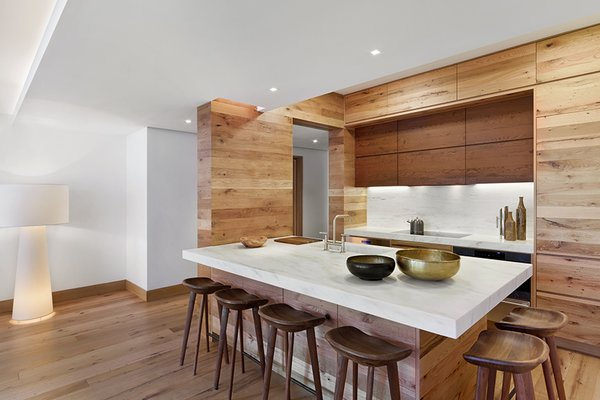 The custom open kitchen pairs strips of reclaimed wood and marble sourced locally from Vermont Danby Marble. Photo 11 of An Historic TriBeCa Building Reborn modern home