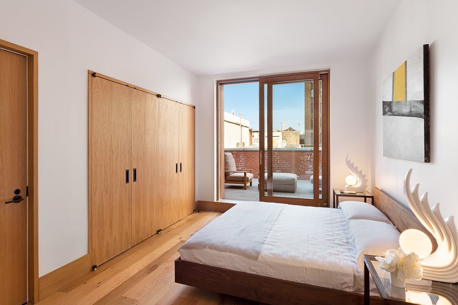 Zola Lift & Slide Door offering outstanding thermal and acoustic performance while showcasing expansive views of downtown Manhattan.  An Historic TriBeCa Building Reborn by Zola Windows