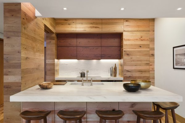 The custom open kitchen pairs strips of reclaimed wood and marble sourced locally from Vermont Danby Marble. Photo 20 of An Historic TriBeCa Building Reborn modern home