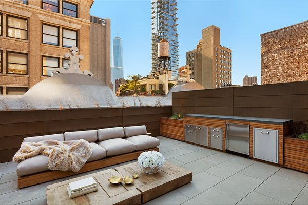 Outdoor deck features Zola Lift & Slide Door offering outstanding thermal and acoustic performance while showcasing expansive views of downtown Manhattan. Photo 15 of An Historic TriBeCa Building Reborn modern home