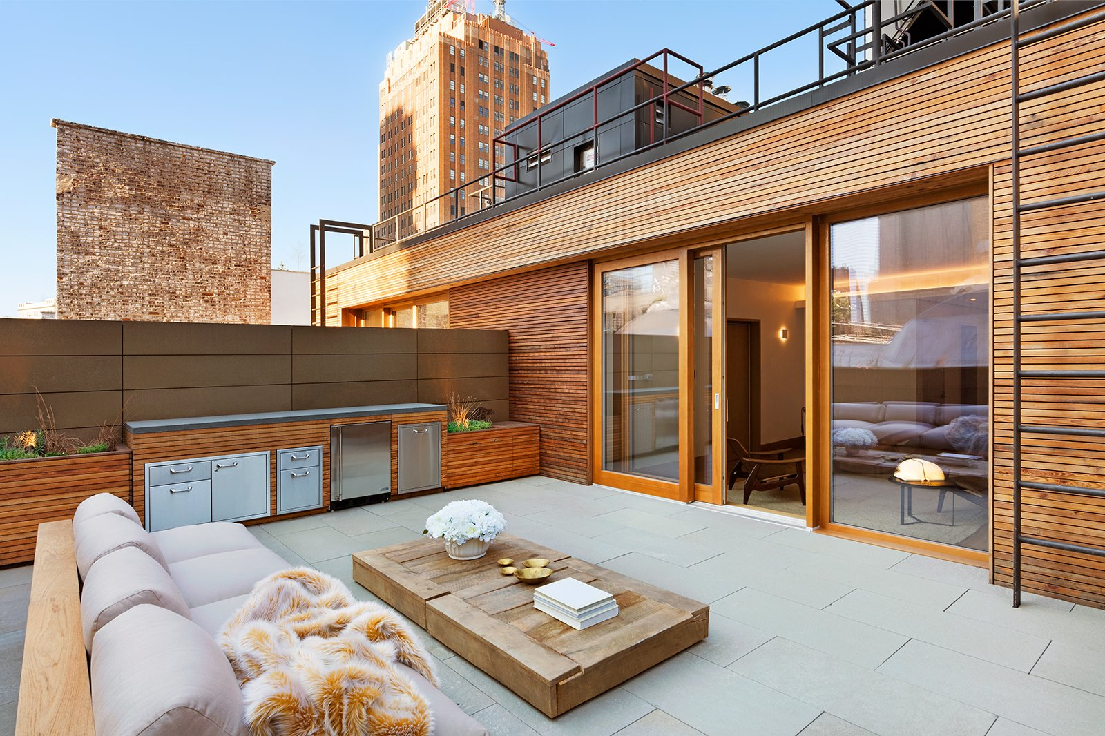 Outdoor Deck features Zola Lift & Slide Door offering outstanding thermal and acoustic performance while showcasing expansive views of downtown Manhattan. An Historic TriBeCa Building Reborn by Zola Windows