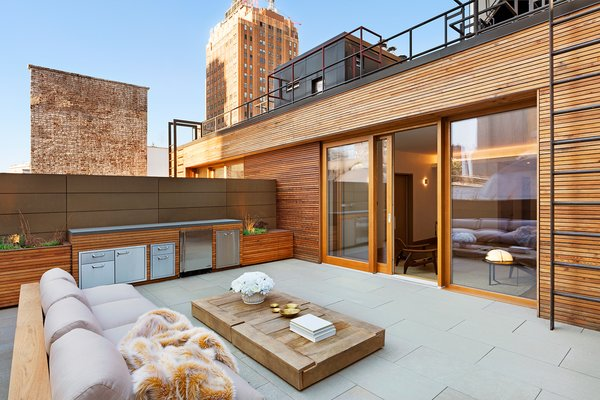 Outdoor Deck features Zola Lift & Slide Door offering outstanding thermal and acoustic performance while showcasing expansive views of downtown Manhattan. Photo 19 of An Historic TriBeCa Building Reborn modern home