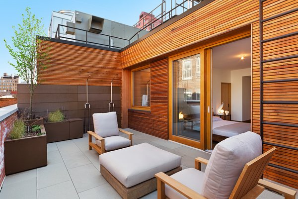 Outdoor Deck features Zola Lift & Slide Door offering outstanding thermal and acoustic performance while showcasing expansive views of downtown Manhattan. Photo 12 of An Historic TriBeCa Building Reborn modern home