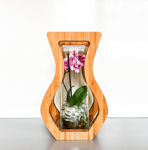 The curvy silhouette vase is designed as an elegant picture frame to dress up the often discarded glass vase that comes with store-bought flowers. Photo 3 of Modern, Minimalist and packed with Meaning modern home