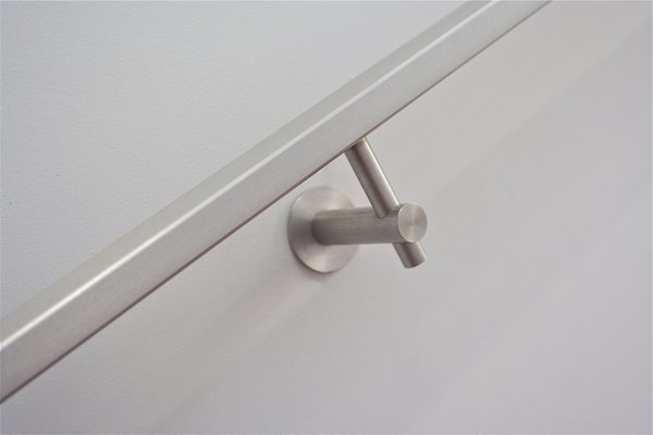 522RSS stainless architectural handrail bracket by Five Twenty Two Industries.