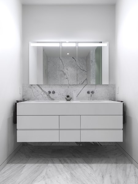 Custom vanity with solid surface counter-top and fascia at the Master Bathroom. The recessed medicine cabinet with integral lighting is by Sidler. Photo 16 of Telegraph Hill Periscope modern home