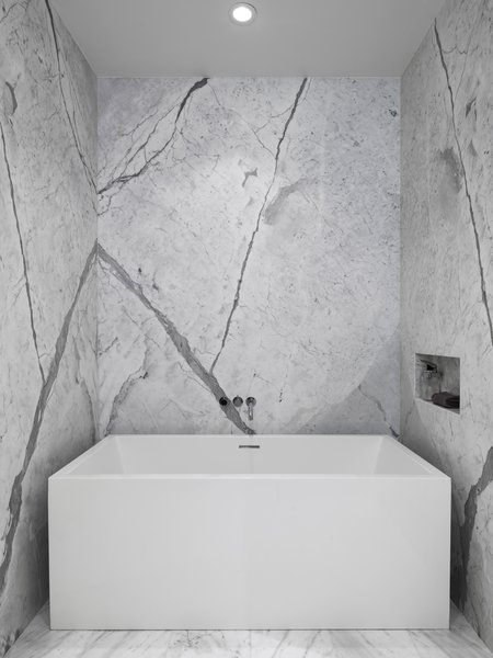 Soaking tub by Wet Style and custom stone niche at the Master Bathroom. Photo 15 of Telegraph Hill Periscope modern home