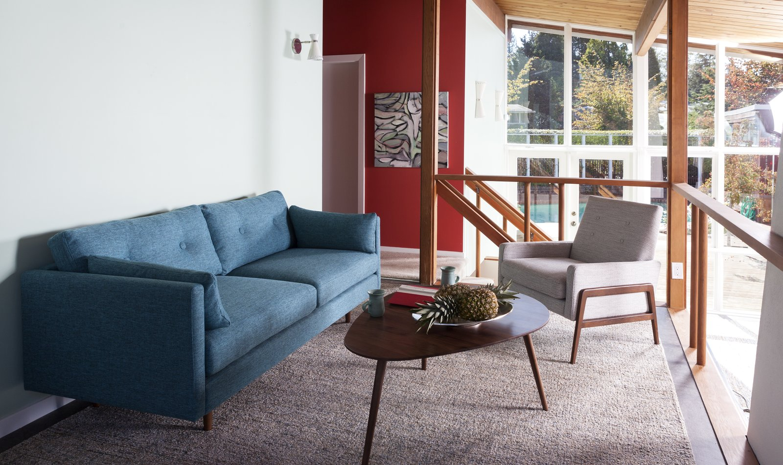 Embracing mid-century. Built in 1953, the Friedman House features a unique study/loft space that overlooks the open-concept first floor. Decorated in Article's mid-century modern pieces, it's like taking a step back through time. Anton sofa, $1149; Amoeba table, $299; Nord chair, $499