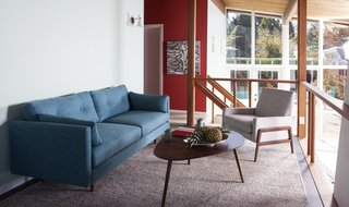 """Styling a Rescued Mid-Century Gem - Photo 2 of 6 - Built in 1953, the Friedman House features a unique loft space that overlooks the open-concept first floor. Decorated in some of our most mid-century modern pieces, it's like taking a step back through time. <span style=""""color: rgb(204, 204, 204); font-size: 13px;"""">Photo: Philippe Martin-Morice</span>"""