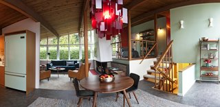 Styling a Rescued Mid-Century Gem - Photo 4 of 6 - Natural cedar planks on the ceiling and posts throughout the main floor create direction for the eye and further evoke the interplay of the indoors and outdoors.