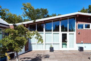 Styling a Rescued Mid-Century Gem - Photo 6 of 6 - Floor-to-ceiling windows on the home's south side flood the main floor with light.