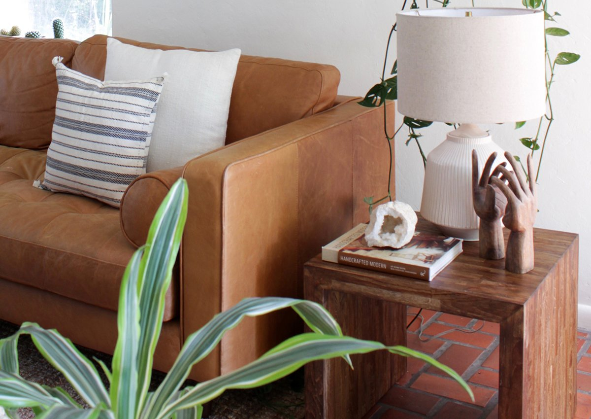 The warm tones of a cognac leather sofa ground a space with lots of color.  Photo 6 of 7 in The Great Indoors