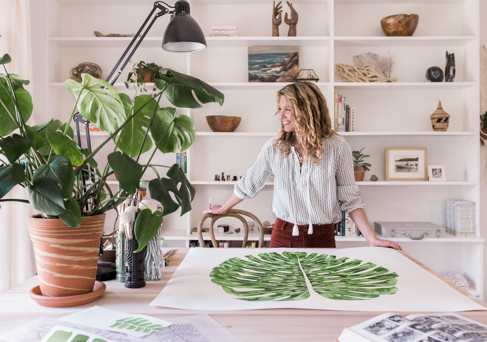 """Jenny describes white space as equally important to her work as her signature green plantlife. """"I'm all about white, negative space. It's just as important as a full page of colour,"""" she says."""