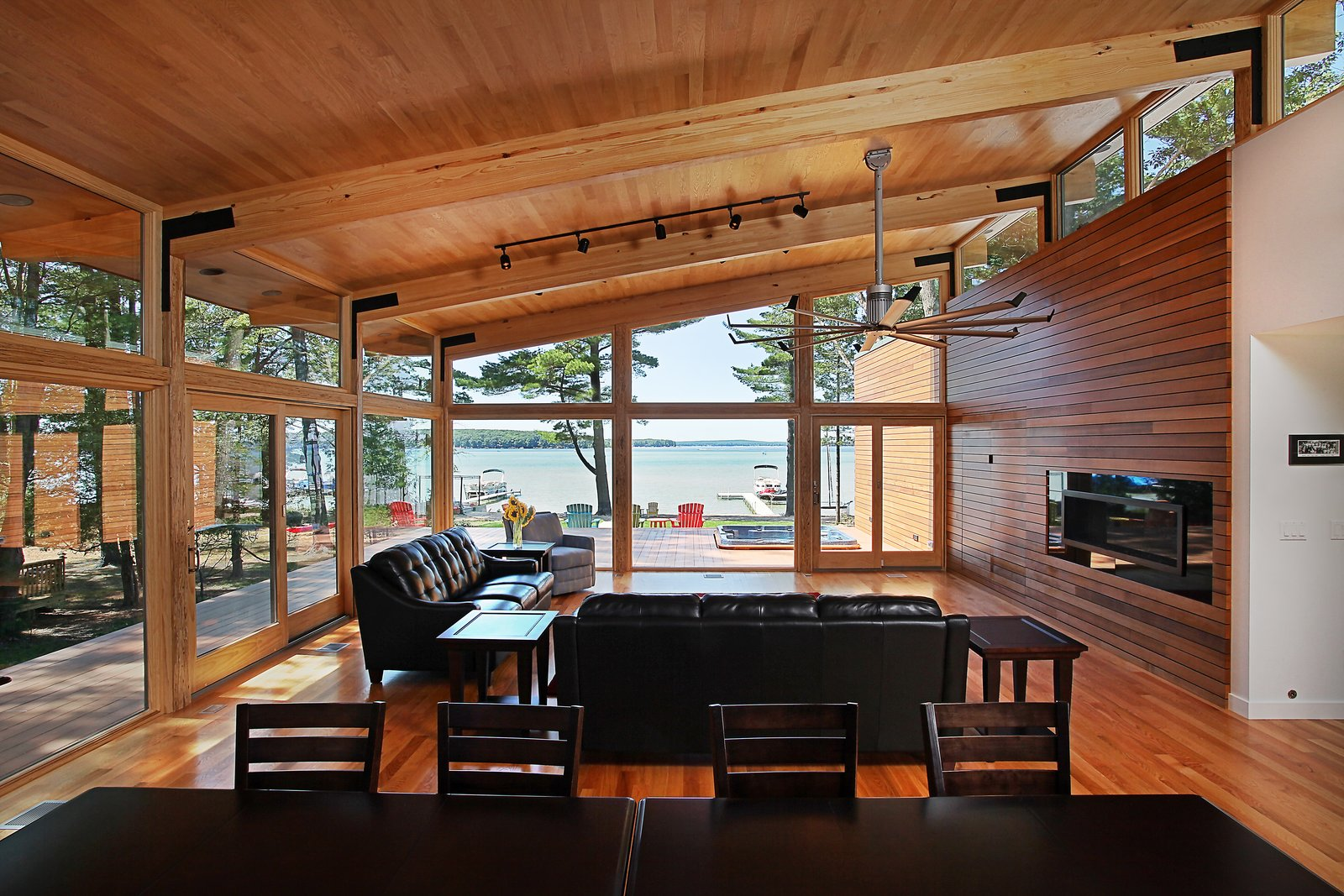 Living room looking toward lake  Higgins Lake House by Jeff Jordan Architects
