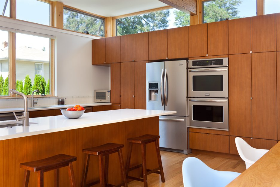 Tagged: Kitchen, Wall Oven, Refrigerator, and Wood Cabinet.  Oak Row House by Jeff Jordan Architects