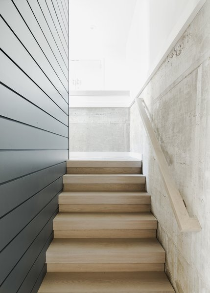 Modern home with staircase, wood tread, and wood railing. Entry stair and concrete wall Photo 20 of Sea Bright House