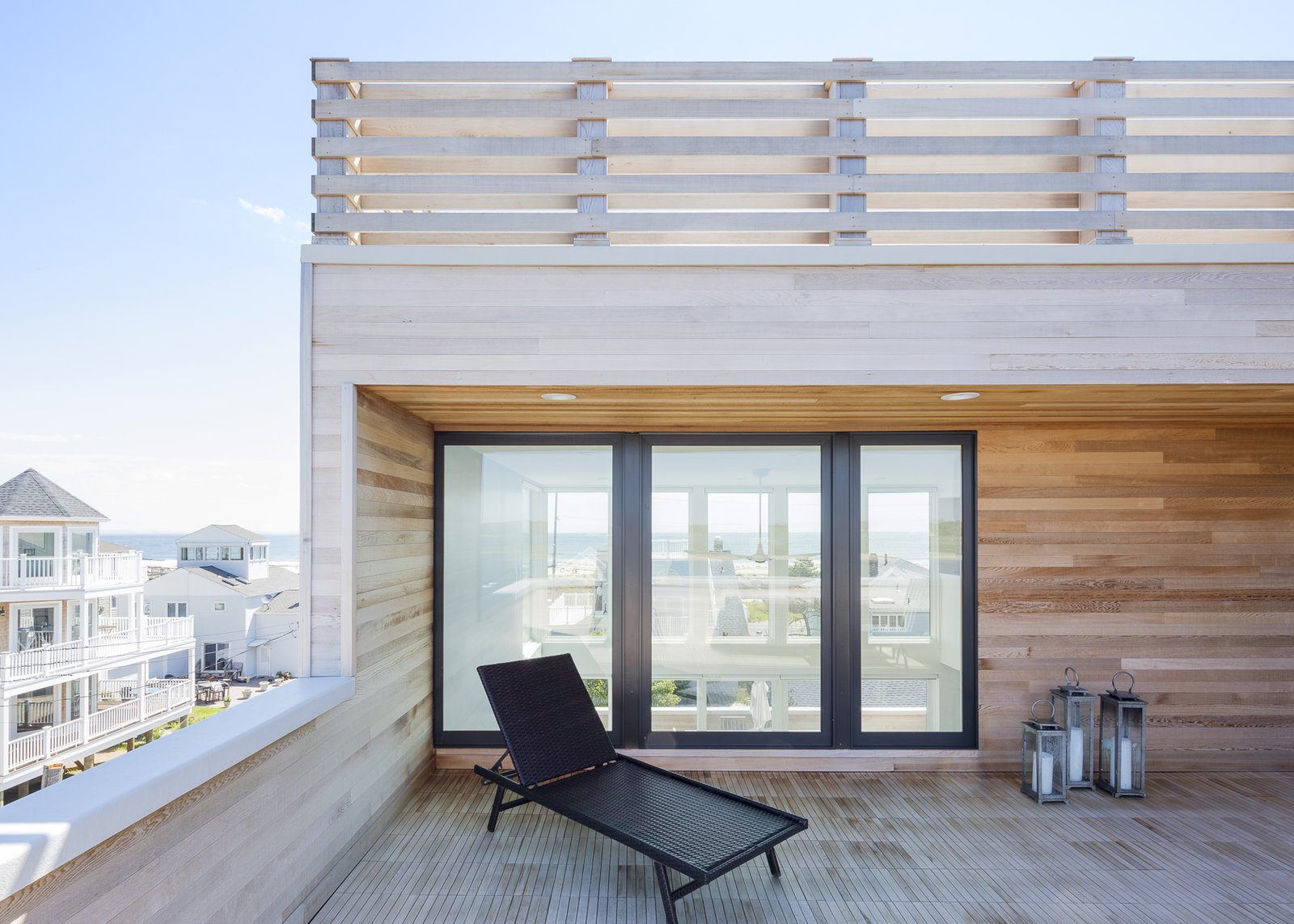 Riverside deck looking through house to ocean Tagged: Outdoor, Horizontal Fences, Wall, Rooftop, Wood Patio, Porch, Deck, Decking Patio, Porch, Deck, and Wood Fences, Wall.  Sea Bright House by Jeff Jordan Architects